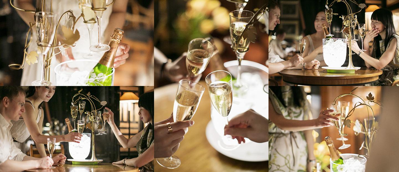 Los invitados de Shini disfrutan del champagne alrededor de «El árbol cautivador»