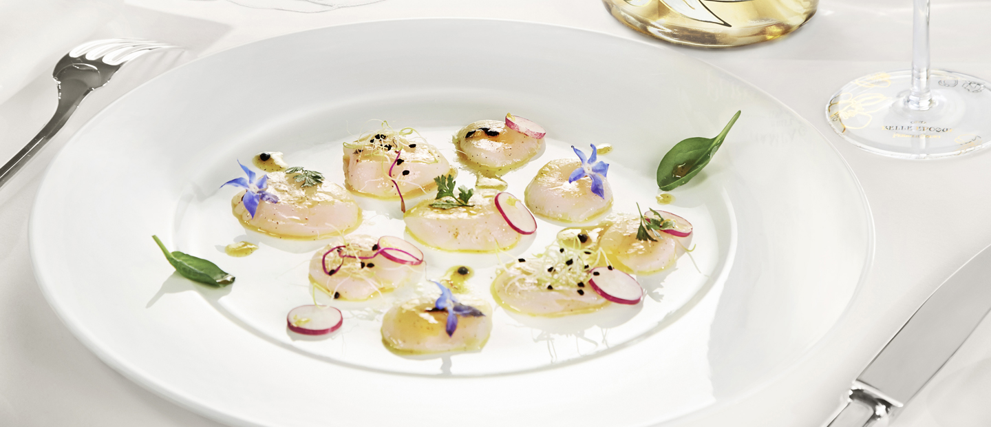 FLOWER-GARNISHED RAW SCALLOP ISLANDS